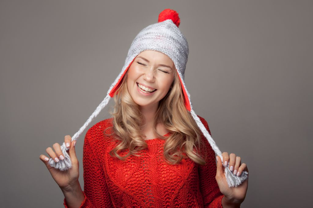 Smiling woman wearing winter clothing